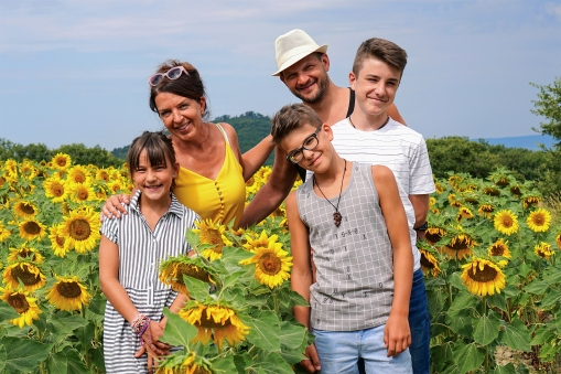 Family in a sunflower field